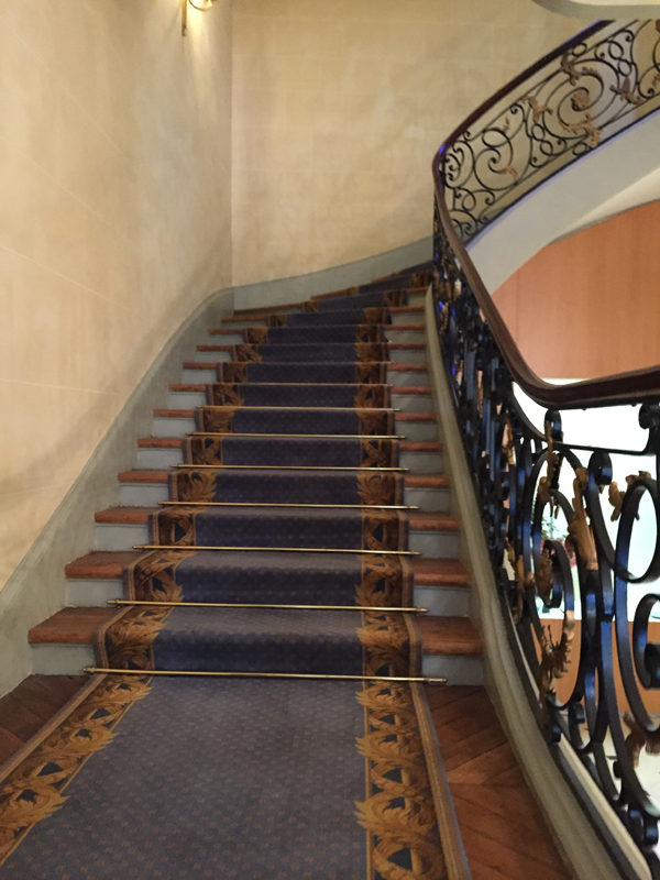 Grand staircase of the La Maison de Polytechniciens a destination wedding venue in Paris