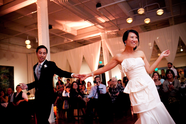 Newlywed couple dancing at wedding reception in San Francisco. Wedding by Jamie Chang of Mango Muse Events.
