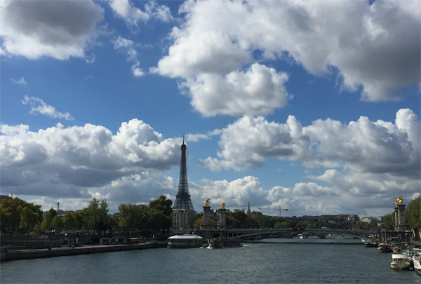 View of the Eiffel tower in Paris from the Seine River by Jamie Chang