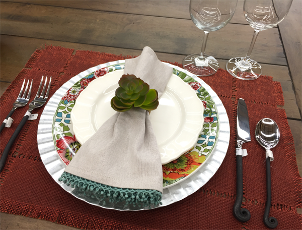Succulent napkin holder idea for a Thanksgiving table setting.