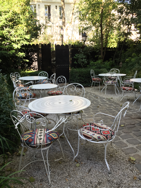 Outdoor seating area of Hotel Particulier Paris wedding venue by Destination wedding planner Mango Muse Events