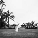 Bride walking down the aisle at an outdoor destination wedding in Hawaii destination wedding planning by Destination wedding planner Jamie Chang of Mango Muse Events