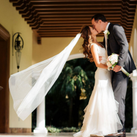 Couple kissing at their destination wedding via all inclusive wedding packages at Casa Velas in Puerto Vallarta, Mexico