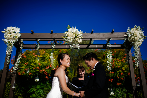 Bride and groom laughing at their wedding ceremony in Sonoma planned by destination wedding planner of Mango Muse Events.