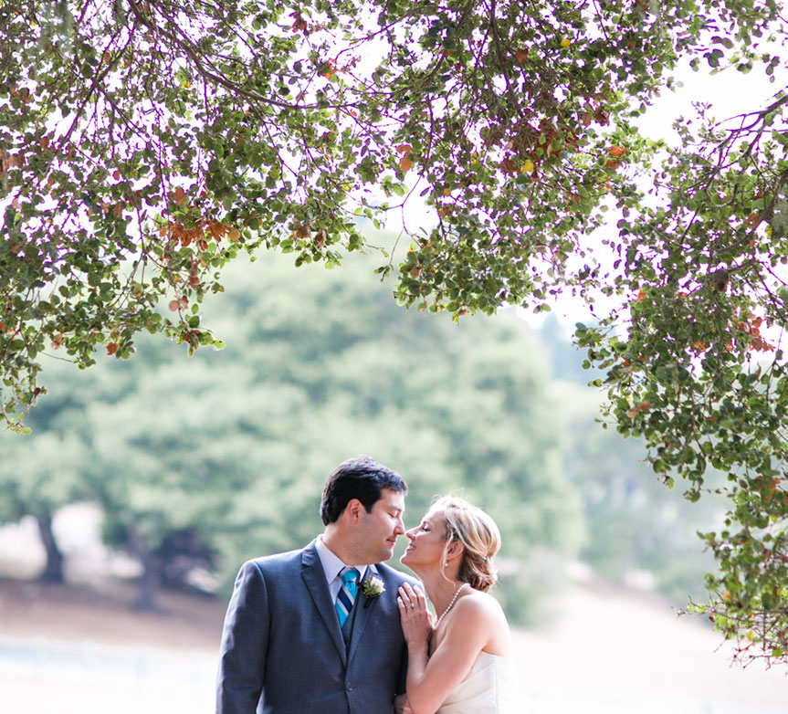 Bride and groom smitten at their Carmel destination wedding by Destination wedding planner Mango Muse Events