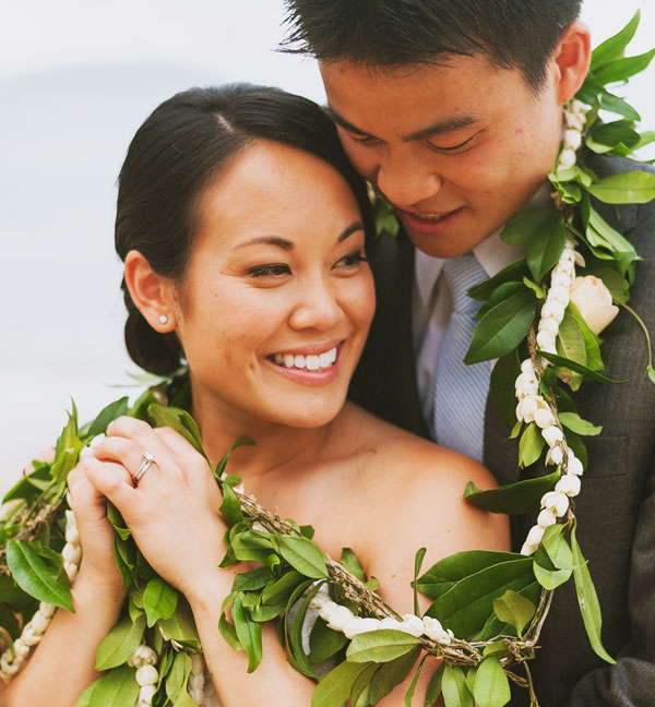 Bride and groom with Hawaiian lei at their Hawaii destination wedding by Destination wedding planner Mango Muse Events