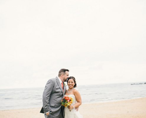 Bride and groom at their beach Hawaii destination wedding by Destination wedding planner Mango Muse Events