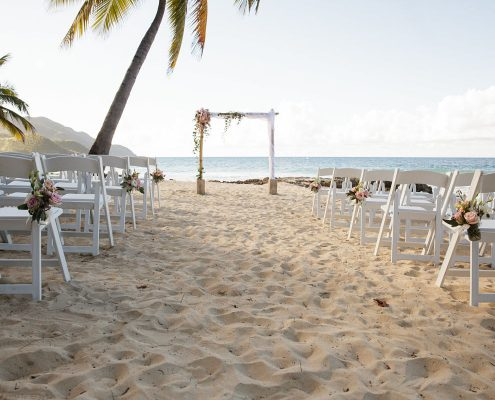 Beach wedding ceremony at the Renaissance Carambola at a Caribbean destination wedding in St. Croix by Destination wedding planner Mango Muse Events