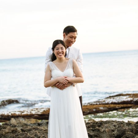 Bride and groom at their beach wedding in Hawaii by Destination wedding planner Mango Muse Events