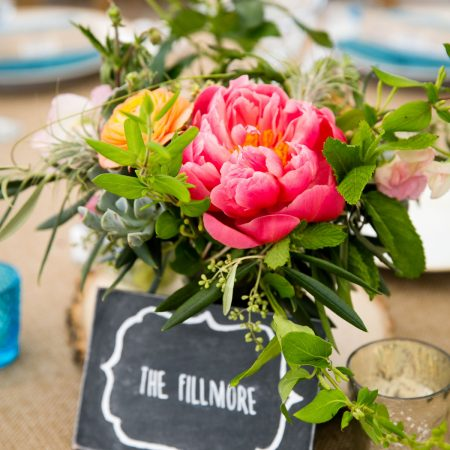Colorful centerpieces at a Sonoma destination wedding by Destination wedding planner Mango Muse Events