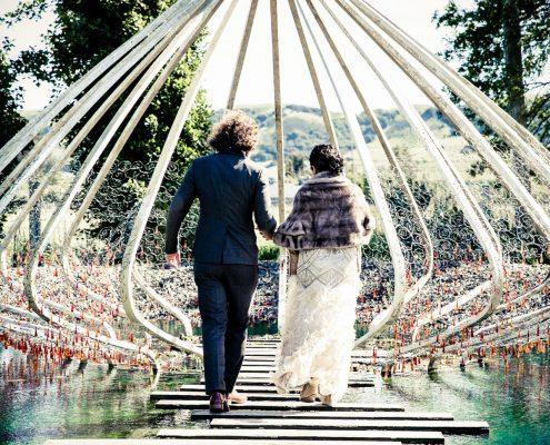 Bride and groom in an art sculpture at Cornerstone Sonoma at their destination wedding by Destination wedding planner Mango Muse Events