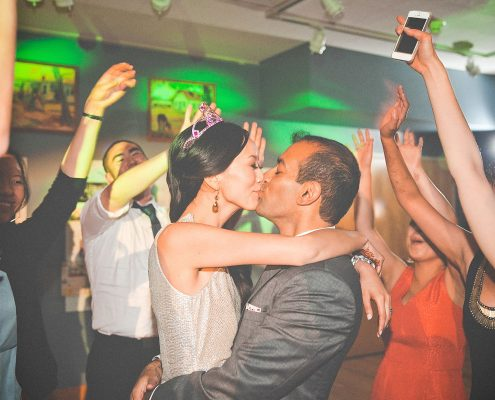 Bride and groom kiss on the dance floor at a multicultural wedding by Destination wedding planner Mango Muse Events