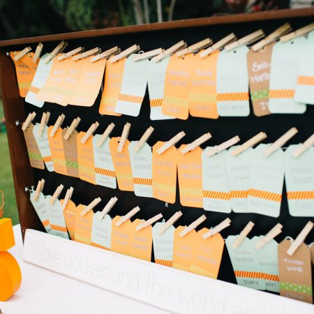 Hanging escort card display at a Hawaii destination wedding by Destination wedding planner Mango Muse Events