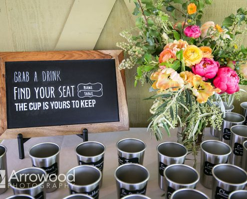 Escort cups for guests to keep at a Sonoma destination wedding by Destination wedding planner Mango Muse Events