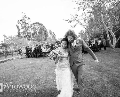Bride and groom hug after ceremony at their Sonoma destination wedding by Destination wedding planner Mango Muse Events