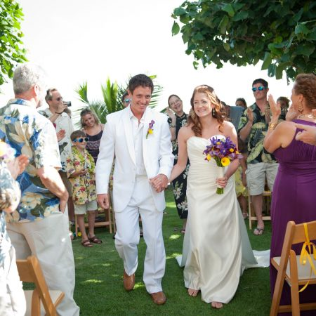 Bride and groom just married at their Hawaii destination wedding by Destination wedding planner Mango Muse Events