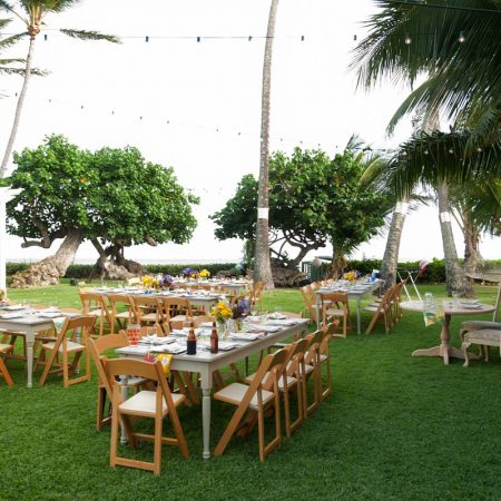 Outdoor wedding reception with custom tables at a Hawaii destination wedding by Destination wedding planner Mango Muse Events