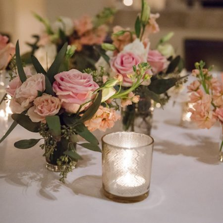 Pink floral centerpieces at a Caribbean destination wedding by Destination wedding planner Mango Muse Events