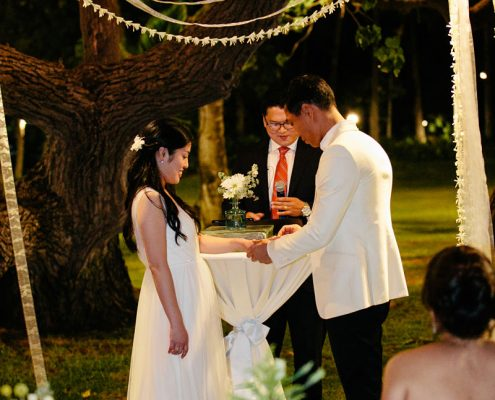 Ring exchange at a night wedding for a Hawaii destination wedding by Destination wedding planner Mango Muse Events