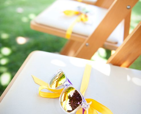 Sunglasses on ceremony chairs for guests at a Hawaii destination wedding by Destination wedding planner Mango Muse Events
