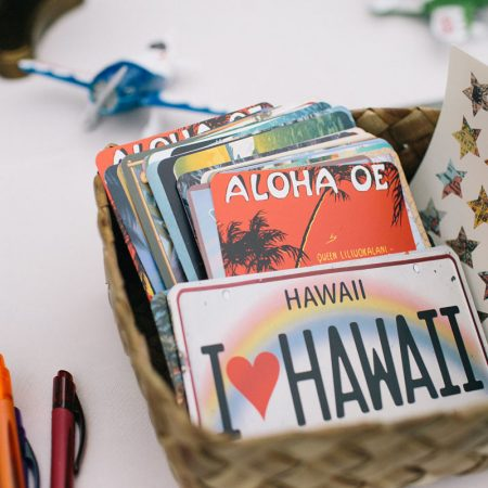 Vintage Hawaiian post cards at a guest book at a Hawaii destination wedding by Destination wedding planner Mango Muse Events