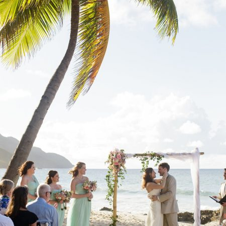 Beach wedding ceremony kiss at a Caribbean destination wedding in St. Croix by Destination wedding planner Mango Muse Events