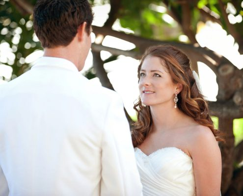 Bride and groom at their wedding ceremony at a Hawaii destination wedding by Destination wedding planner Mango Muse Events