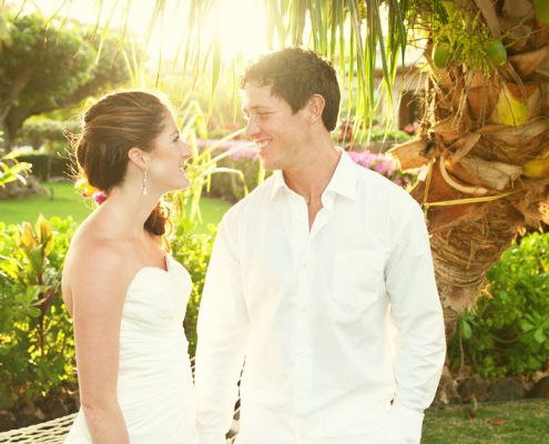 Bride and groom smiling at their Hawaii destination wedding by Destination wedding planner Mango Muse Events