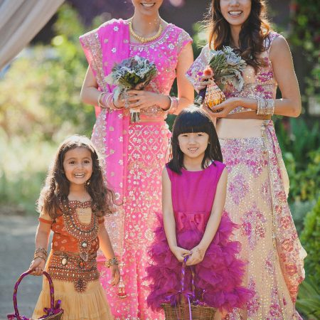 Bride and bridal in colorful dresses for a Hindu ceremony by Destination wedding planner Mango Muse Events