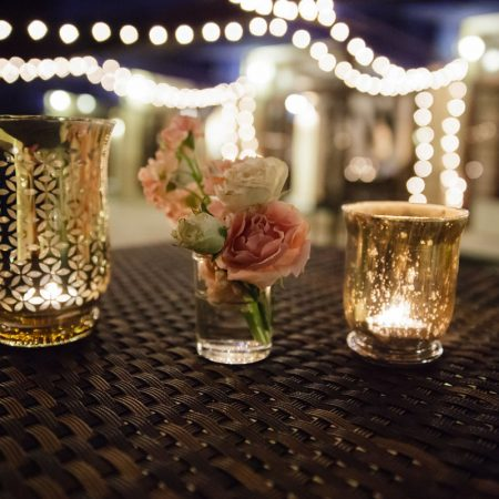 Mercury glass votives and string lights decorate a dance floor at a Caribbean destination wedding by Destination wedding planner Mango Muse Events