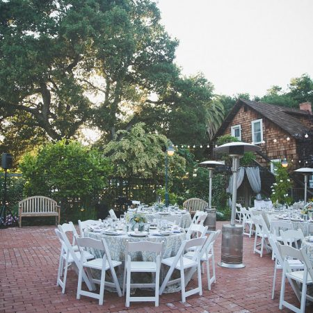 Outdoor wedding reception at the Los Altos History Museum designed by Destination wedding planner Mango Muse Events