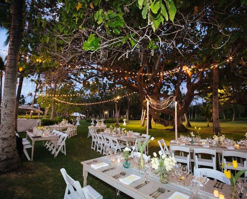 Outdoor wedding reception under string lights at a Hawaii destination wedding by Destination wedding planner Mango Muse Events