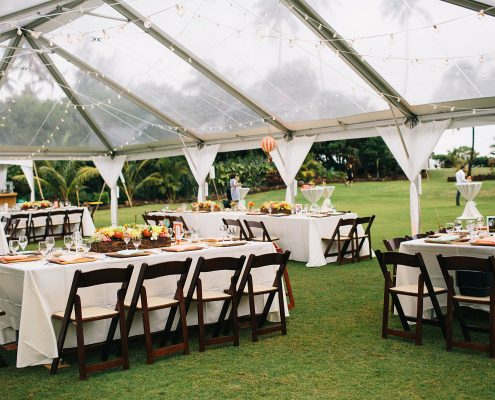 Clear tent and tropical flowers for an outdoor Hawaii destination wedding at Loulu Palm by Destination wedding planner Mango Muse Events