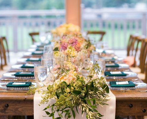 Lush floral garland centerpiece at a Carmel destination wedding by Destination wedding planner Mango Muse Events
