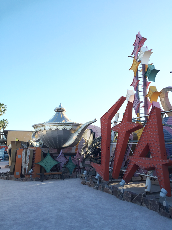 Genie lamp and other neon signs at the Neon Museum, a unique Las Vegas Wedding Venue perfect for a destination wedding