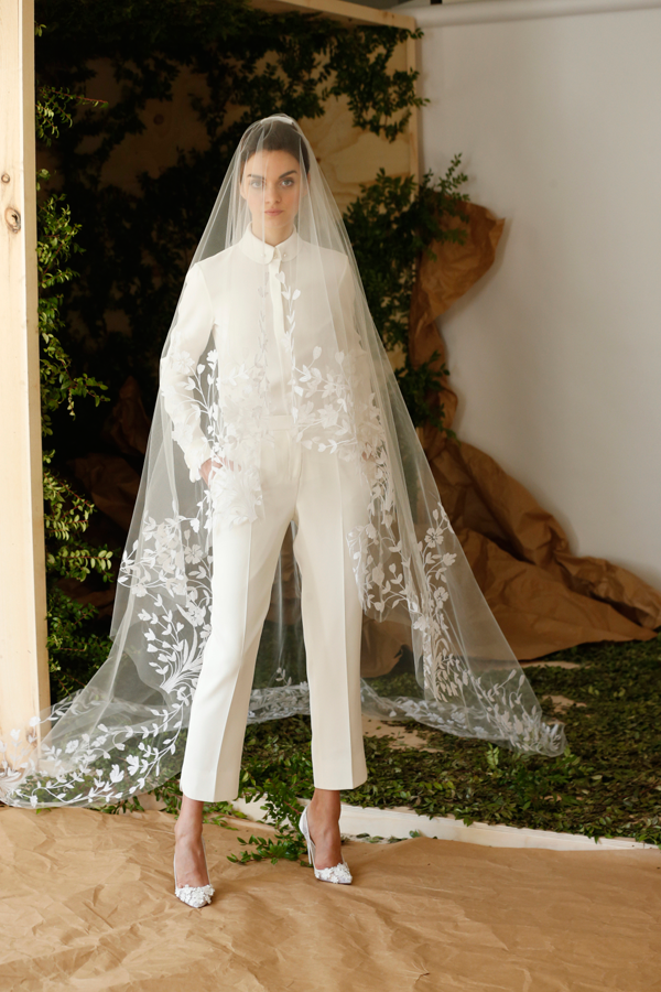 White cropped pants and top by Carolina Herrera, a non-traditional wedding dress idea