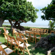 Beachfront wedding ceremony setup at Hawaii destination wedding on a small wedding budget by Destination wedding planner Mango Muse Events