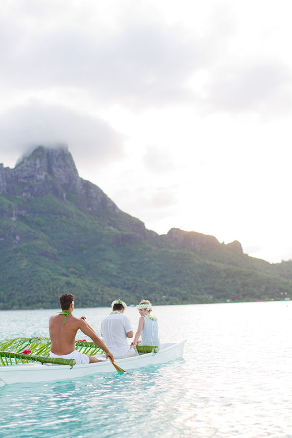 Couple in a kanoe at a destination wedding in Bora Bora, a beach destination wedding location