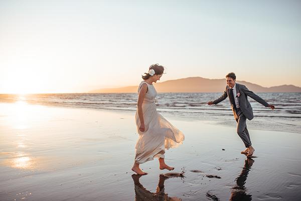 Couple on the beach at a destination wedding in New Zealand, a beach destination wedding location