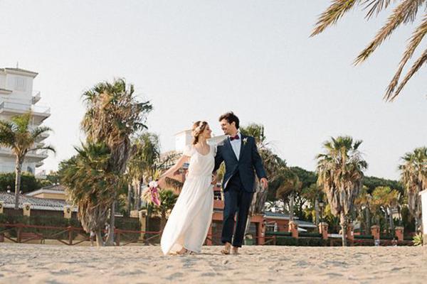 Wedding couple on a beach at their Marbella Spain beach destination wedding