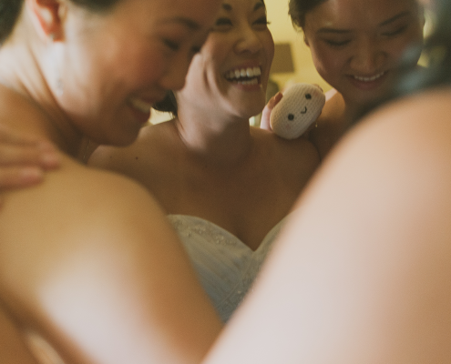 A bride and her bridesmaids having a moment after opening their gifts at a Hawaii destination wedding by destination wedding planner Mango Muse Events