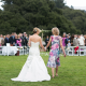 Mother and Bride walk down the aisle hand in hand at a destination wedding in Carmel by Destination wedding planner, Mango Muse Events.