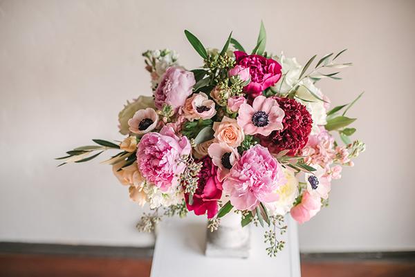 Pink floral centerpiece made by wedding florist, Petite Petal Co.