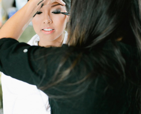 A bride getting ready by her hair and makeup artist, Jane Kim of The Glamourist