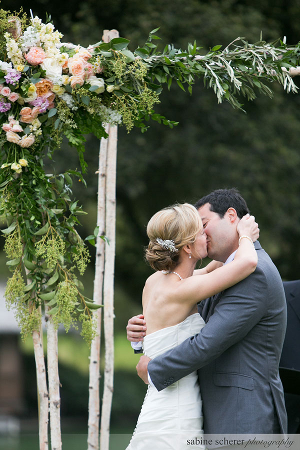 Bride and groom kiss after they get married at this Carmel destination wedding planned by Destination wedding planner, Mango Muse Events