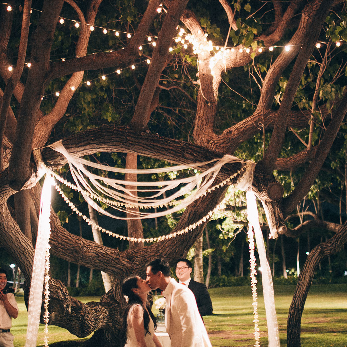 Hawaii destination wedding nighttime ceremony mango muse events bride and groom at a nighttime ceremony for a hawaii destination wedding by destination wedding planner junglespirit Image collections