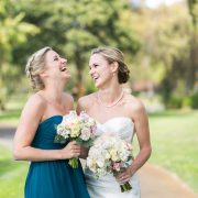 Bride and bridesmaid laughing at a Carmel destination wedding by Destination wedding planner Mango Muse Events