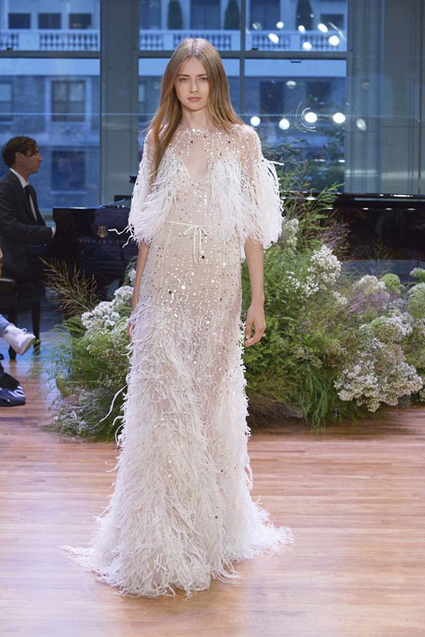 Feather wedding dress and coverup from the Monique Llhuillier bridal fashion week Fall 2017 collection