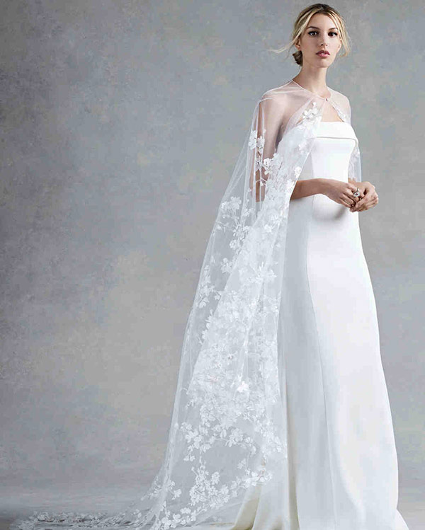 Sheer cape wedding dress from the Oscar de la Renta bridal fashion week Fall 2017 collection