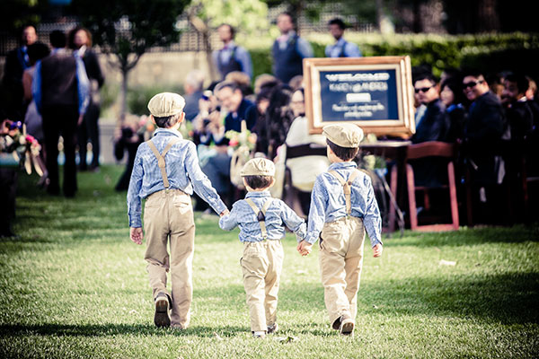 Ring bearers walking down the aisle in their matching children's wedding outfits at a Sonoma destination wedding by Destination wedding planner, Mango Muse Events